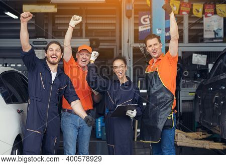 Group Of Mechanics, Professional Mechanic In The Garage. Auto Repair Garage.