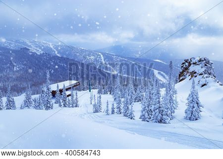 Sheregesh Ski Resort In Russia. Winter Landscape Blue Colored, Trees In Snow And Ski Slope.
