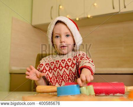 Helper In Santas Hat And Red Sweater Making Cookies. Child Having Fun. Kid Is Preparing Xmas Cookies