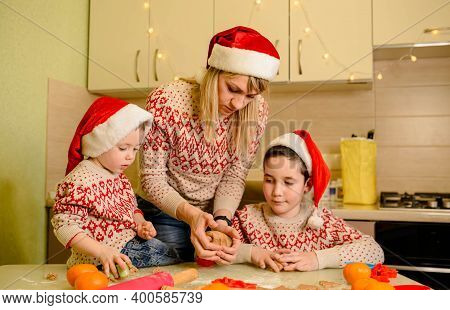 Adorable Boys Are Preparing The Dough, Baking Gingerbread Cookies In The Kitchen On Winter Day. Funn