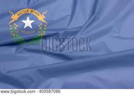 Fabric Flag Of Nevada. Crease Of Nevada Flag Background, The States Of America, Two Sagebrush Branch