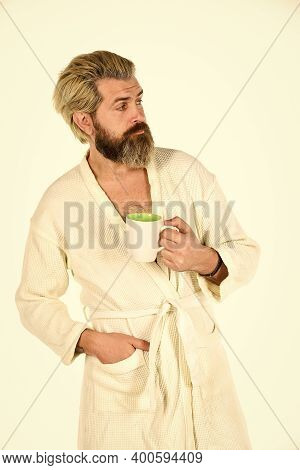 Enjoying Morning Coffee. Man In Bathrobe Drink Coffee At Luxury Hotel In Morning. Man Drink Tea Rela