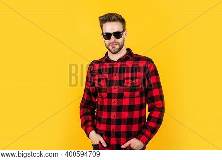 Cool And Sexy. Well Groomed Hairstyle. Male Beauty And Fashion Look. Checkered Shirt For Bearded Guy