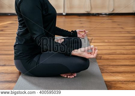 Cropped Image Of Young Lady Make Yoga Exercises Sitting In Lotus Asana
