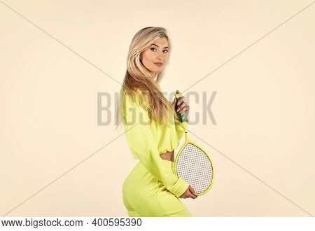 Relaxing After Training. Sporty Woman Hold Tennis Racquet. Female Tennis Player Isolated On White. G