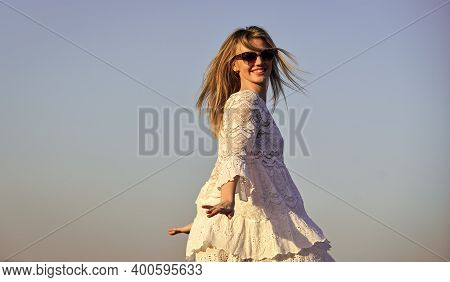 Impulsiveness And Ease. Naturalness Concept. Dancing Woman. Mental Health. Girl Blue Sky Background.