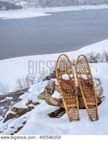 classic snowshoes in winter scenery of Horsetooth Reservoir in northern Colorado