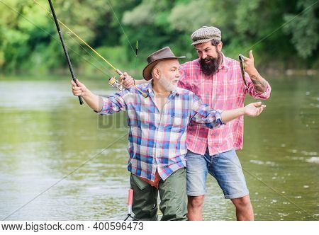 Atomic Hobby. Fly Fishing Time. Hobby. Two Happy Fisherman With Fishing Rod And Net. Big Game Fishin