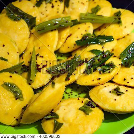 Dhokla Khaman Home Made With Coriander Garnishing On Plate, Fresh And Hot Yellowish Khaman Dhokla Wi
