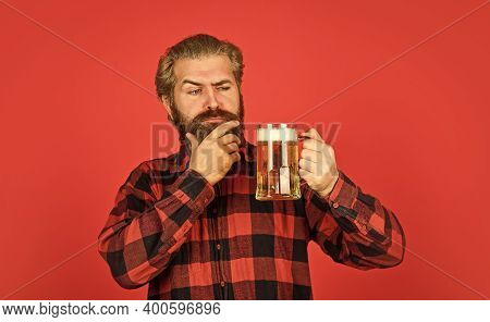 Brew House. Mature Bearded Barman Hold Beer Glass. Confident Bartender Raising Toast. Leisure And Ce