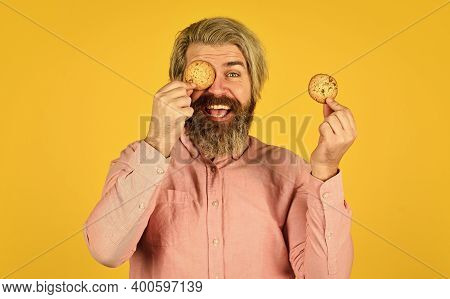 Sweet Cookies. Sweet Tooth Concept. Cookies On His Mind. Bearded Man Hold Cookies On Eyes. Yummy Del