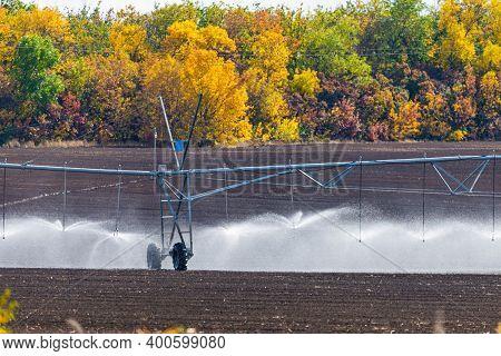 Modern Irrigation System Watering A Farm Field.