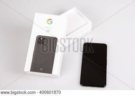 Bordeaux , Aquitaine  France - 20 15 2020 : Google Pixel 5 Phone With Open Box In Grey Table Backgro