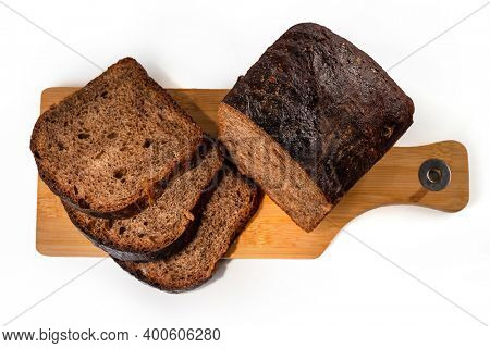 Freshly baked homemade artisan sourdough rye and Rye flour bread on wooden board isolated on white background. Sliced. Top view. Close up. Copy space.