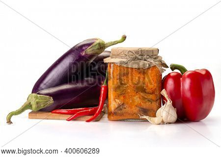 Spicy spicy eggplant saute with paprika, chili and garlic. Grilled eggplants. Vegan food. Isolated on white background