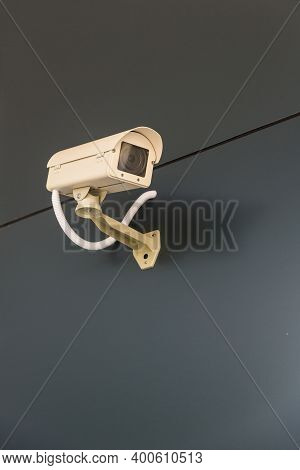 Security Cctv Camera Surveillance System Outdoor Of House. A Blurred Night City Scape Background. Mo
