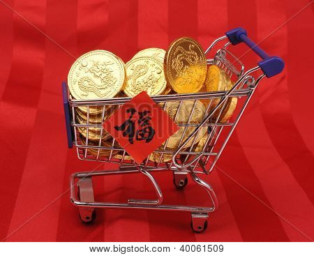 """Gold coins in shopping cart,Chinese New Year Calligraphy for """"Fu"""", good fortune before will start chinese new year"""