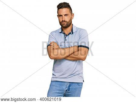 Handsome man with beard wearing casual clothes skeptic and nervous, disapproving expression on face with crossed arms. negative person.