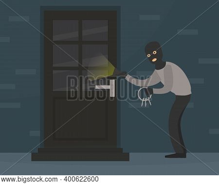 Male Burglar In Balaclava Committing Robbery, Theft Trying To Unlock Door With Lock Pick Breaking In