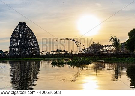 Landscape Of Beautiful Sunset With River And Silhouette Of Bridge Made From Bamboo For Viewpoint At