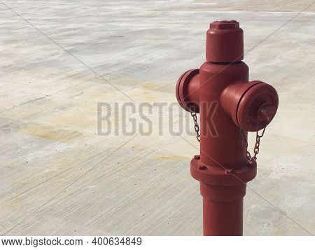 Red Fire Hydrant Against Concrete Background. Fireman Equipment