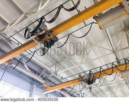 Overhead Cranes Inside Industrial Building. Bridge Cranes Inside Hangar