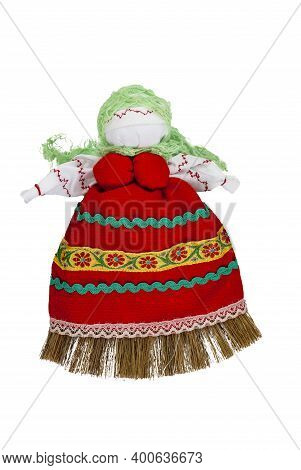 Traditional Home-made Russian Doll Made Of Fabric. A Doll In A Green Scarf And A Red Sundress.