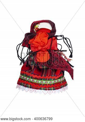 Traditional Home-made Russian Doll Made Of Fabric. A Doll With A Child In Her Arms.