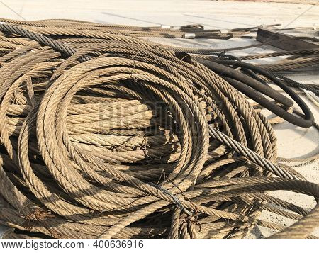 Coiled Steel Cables Of Lifting Machinery. Crane Parts At Outdoor Warehouse