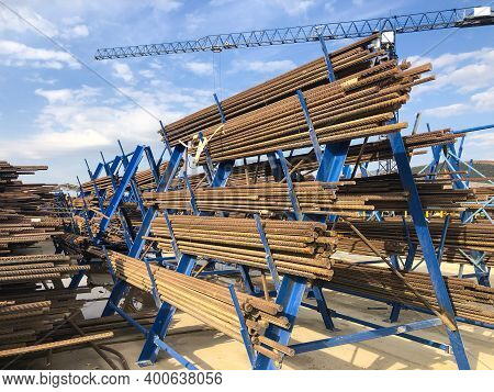 Metal Reinforcement Parts On Metal Racks At Outdoor Warehouse At Construction Site