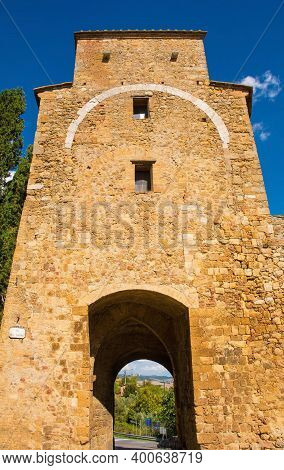 The fifteenth century Porta Cappuccini, one of the gates to the historic medieval village of San Quirico d\'Orcia, Siena Province, Tuscany, Italy. Also known as the Gate of the Capuchin Friars