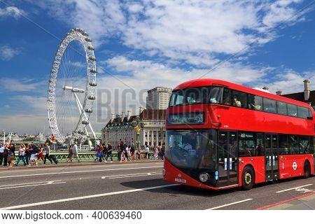 London, Uk - July 7, 2016: People Walk By London Eye In London. The Eye Is The Tallest Ferris Wheel