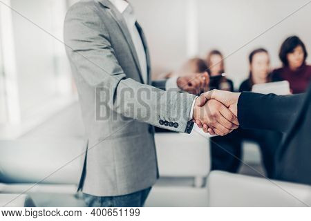 Close Up. Young Entrepreneur Shaking Hands With His Business Partner