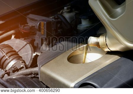 Refueling And Pouring Engine Oil Into The Car Engine Checking And Car Maintenance Concept, Selective