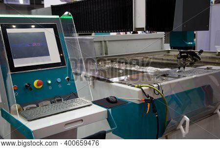 Modern Cnc Abrasive Water Jet Cutting Machine Using High Pressure Water Jet To Cut Metal. Industrial