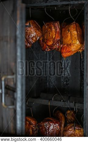 Close Up Of Smoked Meat And Belly Or Beech Meat With Dark Crust In The Smokehouse Or Smoker, Food Co