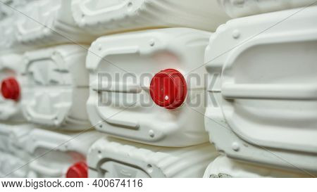 Stacks Of White Plastic Canisters Standing On Waste Separation Station, Widescreen. Garbage Sorting