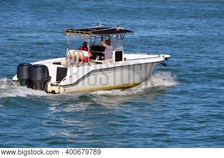 Open White Fishing Boat Powered By Two Outboard Engines.