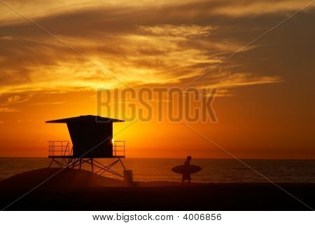 Surfer At Sunset.