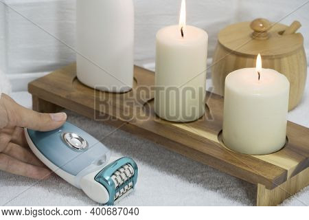 Home Spa Salon. Electric Epilator. Hair Removal At Home. Beauty Concept Of Quarantine. Home Skin Car