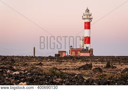 Fuerteventura, Spain - February 17, 2018: Scenic View Of El Toston Lighthouse In Canary Islands Amid