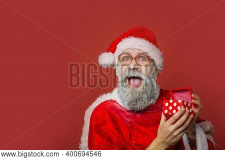 Father Christmas, Santa Claus, Father Frost, Father Christmas Hat. Santa Claus Hands Holding Giftbox