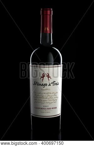 IRVINE, CA - 22-DEC 2020: A 750 ml bottle of Menage a Trois California Red Wine 2017 vintage. Produced by the award winning winery Folie a Deux in Sonoma.