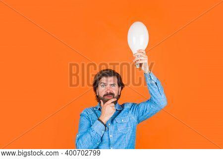 Idea. Thinking Man. Good Idea. Idea. Lamp In Hand. Thoughts. Idea Concept. Bearded Man Holds Light B