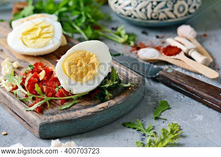Boiled Chicken Eggs. The Process Of Cooking Boiled Marinated Chicken Eggs With Vegetables, Herbs, Sp