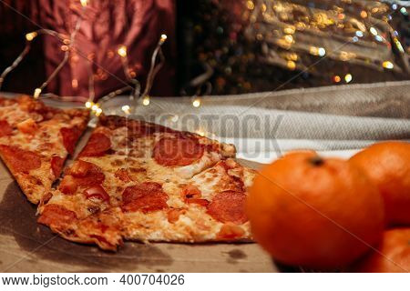 Christmas Salami, Pepperoni Pizza With Decoration, Gifts, Green Tree Branch On Wooden Rustic Table.
