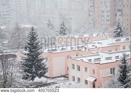 Snowfall In The City. Blizzard Covered Houses And Streets With Snow. Bad Weather Conditions. Beautif
