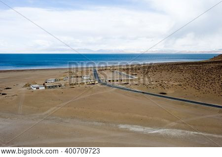 A Village Near A Tibetan Lake And A Road To It. A Lake In The Himalayas. Tibet, A Large Lake In The
