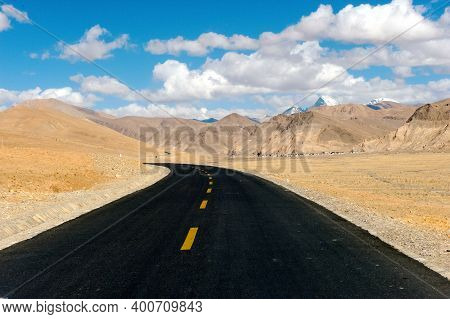 Asphalt Road In Tibet. The Track In The Himalayas.