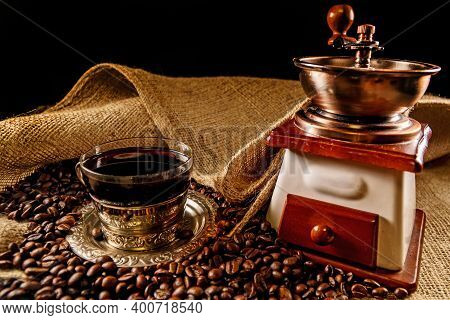Vintage Coffee Grinder, Coffe Beans And Coffee Cup.